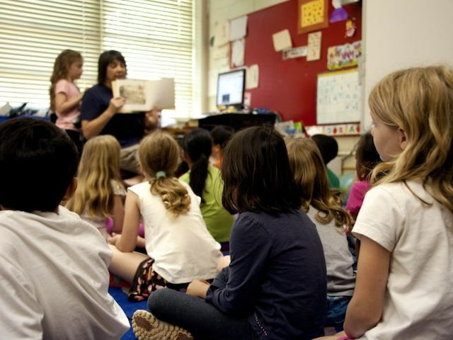Typical classroom scene where an audience of school children were seated on the floor 725x482.jpg?ixlib=rails 0.3