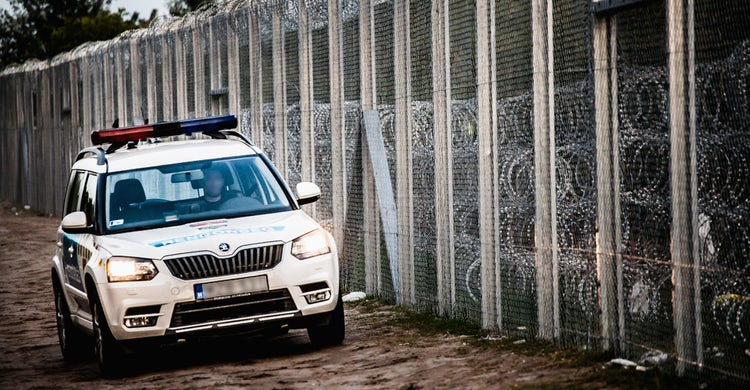 Police car at hungary serbia border barrier.jpg?ixlib=rails 0.3