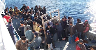Boat people at sicily in the mediterranean sea.jpg?ixlib=rails 0.3