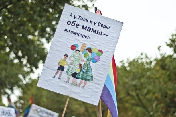 "This anti-homophobia sign reads, ""Tolia and Vera have two moms, both are engineers"" in Russian. (Image: Marco Fieber)"