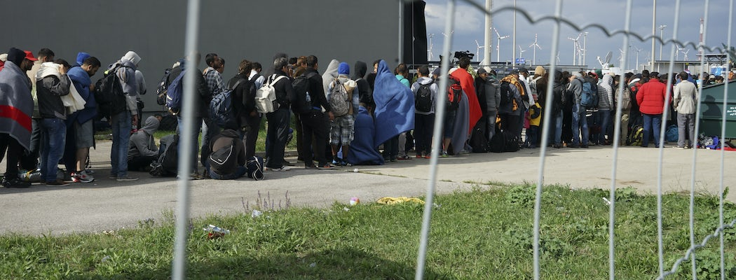 A line of syrian refugees crossing the border of hungary and austria on their way to germany. hungary  central europe  6 september 2015.jpg?ixlib=rails 0.3