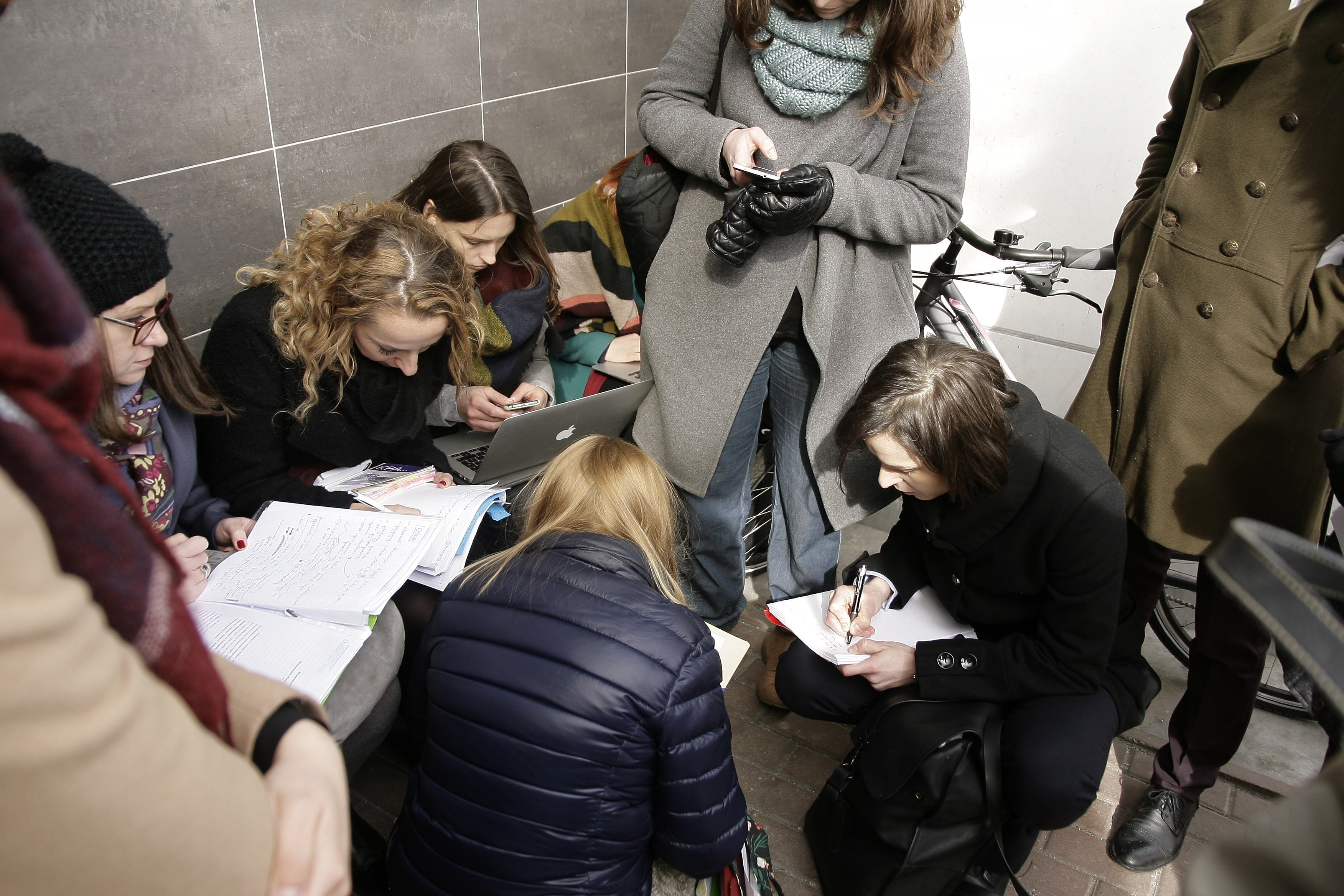 The Terespol crossing station is notorious for rights abuses against asylum seekers. Here, lawyers from human rights organizations huddle at the station to prepare documents for their clients. (Image: HFHR)