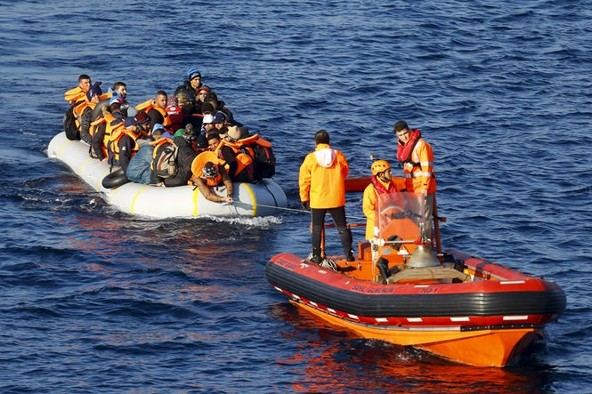 A Turkish Coast Guard boat tows refugees in Turkish territorial waters, following a failed crossing to the Greek island of Lesbos. (REUTERS/Umit Bektas/Files)