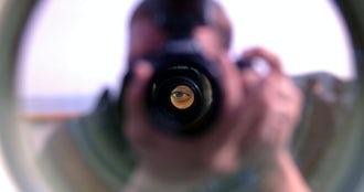 Us navy 050419 n 7526r 047 lt.j.g. genni williamson looks through the big eyes binoculars on the bridge wing aboard uss blue ridge  lcc 19  as journalist seaman apprentice marc rockwell pate takes a photograph.jpg?ixlib=rails 0.3