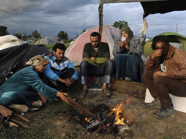 Refugeesfiregreece.png?ixlib=rails 0.3