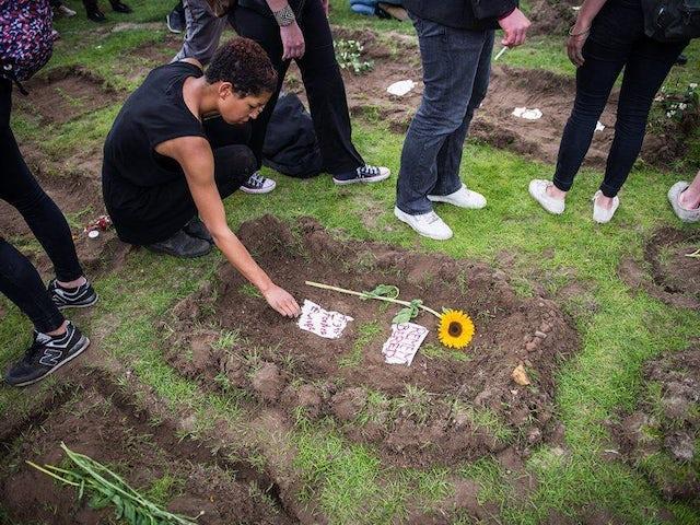 Migrant funeral germany.jpg?ixlib=rails 0.3