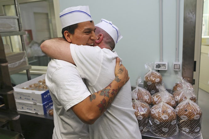 Some prison initiatives are having a positive impact on inmates and give them valuable experience, such as baking panettone.  (Image: Alessandro Bianchi, Reuters)