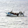 Refugees on a boat  1 .jpg?ixlib=rails 0.3