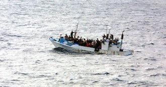 Refugees on a boat  1 .jpg?ixlib=rails 0.3