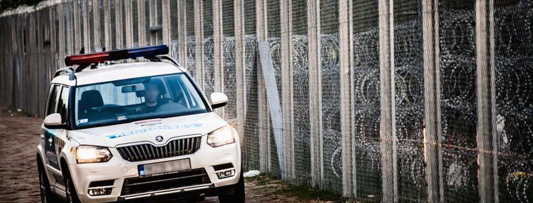 Police car at hungary serbia border barrier.jpg?ixlib=rails 0.3