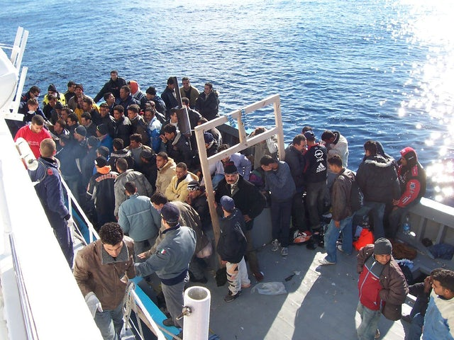 Boat people at sicily in the mediterranean sea.jpg?ixlib=rails 0.3