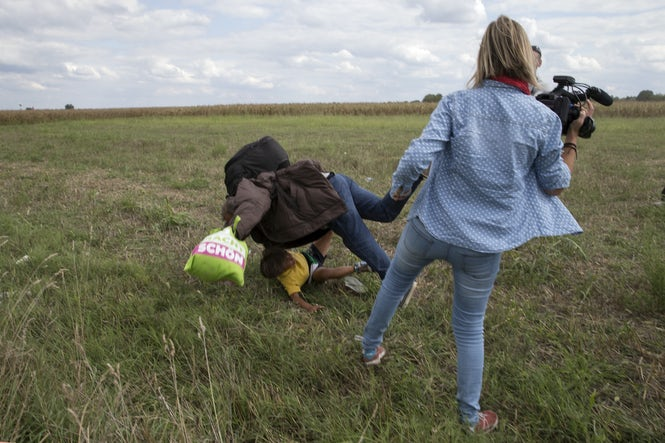 Reporters' coverage of the refugee crisis got international attention after Hungarian camerawoman Petra Laszlo tripped a running migrant and his son in September 2015. (REUTERS/Marko Djurica)
