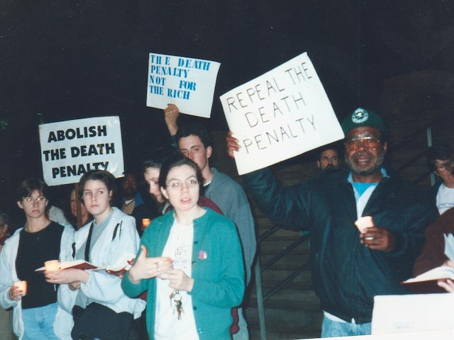 Group of people holding signs at a death penalty protest.jpeg.jpeg?ixlib=rails 0.3