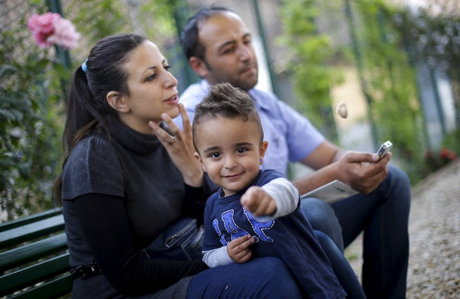 Syrian couple Hassan Zaheda, 31, and Nour Essa (L), 30, and their son Riad, 2, in Rome in April 20. Refugees families are finding it difficult to integrate into Italian society.  (REUTERS/Max Rossi)